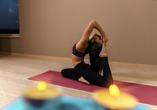 Attractive girl in yoga pose royalty free stock image