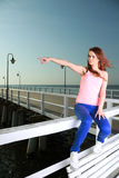 Attractive girl Young woman looking at sea Stock Images