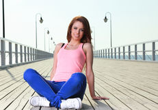 Attractive girl Young woman pier sea Stock Photography
