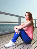Attractive girl Young woman pier sea Stock Images