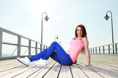 Attractive girl Young woman pier sea Royalty Free Stock Image