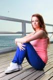 Attractive girl Young woman pier sea Stock Photos