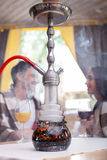 Attractive girlfriend and boyfriend with hookah in Stock Photo