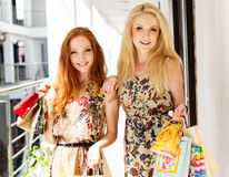 attractive girls happy out shopping two стоковое изображение rf