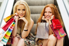 attractive girls happy out shopping two Стоковые Изображения