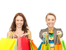 Attractive girls holding color shopping bags Stock Image