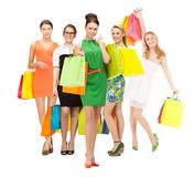 Attractive girls holding color shopping bags Royalty Free Stock Photography