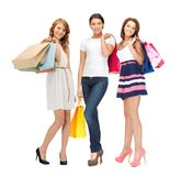 Attractive girls holding color shopping bags Royalty Free Stock Photos