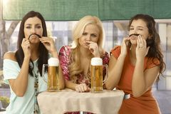 Attractive girls with moustache Stock Image