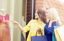 Attractive girls shopping in the city center Royalty Free Stock Photo