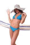Attractive girlwearing bikini with summer hat Stock Image