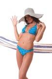 Attractive girlwearing bikini with summer hat Stock Image