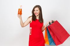 Attractive glamour caucasian fashionable young smiling woman in red dress isolated on white background. Copy space advertisement stock image