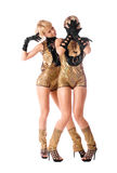 Attractive go-go girls in gold costumes isolated Royalty Free Stock Images
