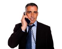 Attractive and gorgeous businessman with a phone Stock Images