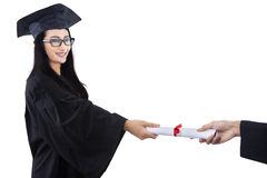 Attractive graduate given certificate - isolated Stock Photo