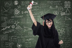 Attractive in graduation gown Royalty Free Stock Image
