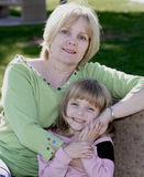Attractive Grandmother with Granddaughter. Content Grandmother In Park With Grandchild Stock Photos