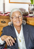 Attractive Grandmother sitting Stock Photography