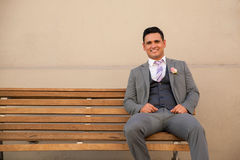 Attractive groom on a bench Royalty Free Stock Photos