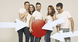 Attractive group of friends with signs Royalty Free Stock Photography