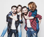 Attractive group of happy young men and women. Royalty Free Stock Photography