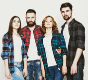 Attractive group of happy young men and women. Royalty Free Stock Image
