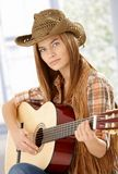 Attractive guitar player practicing in western hat Stock Photo