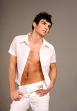 Attractive guy. Dressed in the unbuttoned shirt Stock Photography
