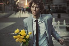 Attractive guy. With bunch of tulips Royalty Free Stock Images