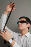 Attractive guy in 3D eyepieces with a film Royalty Free Stock Image