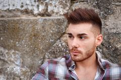 Attractive guy with beard. And a old wall of background Stock Photo