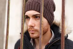 Attractive guy behide the bars stock photos