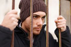 Attractive guy behide the bars royalty free stock photos
