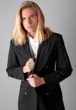 Attractive Guy in Blazer. A portrait of an attractive young man in a black blazer, staring at the viewer stock photo