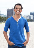 Attractive guy in a blue shirt with cityscape in the background Stock Photos