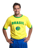 Attractive guy with brazilian jersey laughing at camera Stock Images