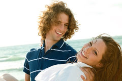 Attractive guy carrying woman Stock Photo