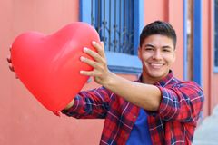 Attractive guy celebrating Saint Valentines.  stock photography