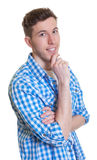 Attractive guy in a checked shirt looking at camera Stock Photo