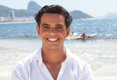 Attractive guy at Copacabana beach at Rio de Janeiro Stock Images