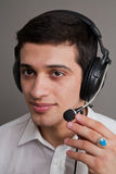 Attractive guy in ear-phones stock photography