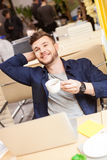 Attractive guy is enjoying hot beverage Royalty Free Stock Images