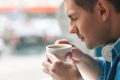 Attractive guy is enjoying hot beverage Royalty Free Stock Photo