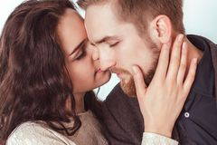Attractive guy with a girl kissing royalty free stock photography