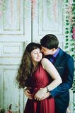 Attractive guy with a girl kissing in the room royalty free stock photography