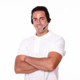 Attractive guy with headphones crossing his arms Stock Images