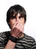Attractive guy is holding his nose Royalty Free Stock Images