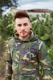 Attractive guy with military jacket Stock Images