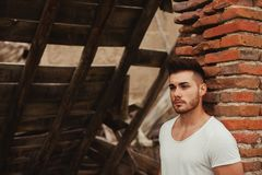 Attractive guy next to a brick wall Royalty Free Stock Image